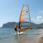 Windsurfer starting sailing on the waves — Stock Photo