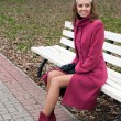 Young elegant girl in purple coat — Стоковое фото #1036794