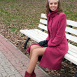 Foto de Stock  : Young elegant girl in purple coat