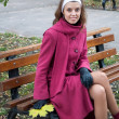 Young elegant girl in purple coat — Stock Photo