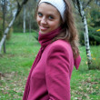 Young beautiful girl in pink coat — Stok fotoğraf