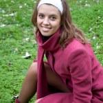 Beautiful girl among the green grass — Stock Photo