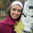 Young beautiful girl near a birch tree — Stok fotoğraf
