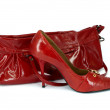 Red stiletto shoe and handbag - Stock Photo