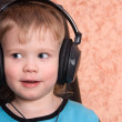 Stock Photo: Child in ear-phones