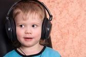 Child in ear-phones — Stock Photo