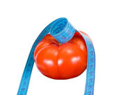 Tomato and tape measure — Stock Photo