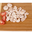 Mushrooms on chopping board — Stock Photo