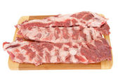 Meat on a chopping board — Stock Photo