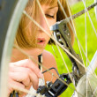 Woman and bike — Stock Photo #1005996