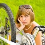 Woman and bike — Stock Photo