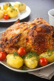 Chicken roasted in mustard sauce garnished with boiled potatoes and cherry tomatoes — Stock Photo