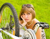 Woman and bike — Stock Photo
