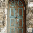Retro styled door in old stone house — Stock Photo