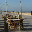 Empty Street cafe on the sea promenade - Stock Photo