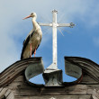 Royalty-Free Stock Photo: Stork and a cross