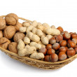 Set of nuts in a wicker basket — Stock Photo