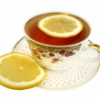 A cup of tea and slices of lemon - Stock Photo