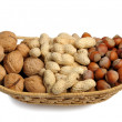 Set of nuts in a wicker basket, isolated — Stock Photo