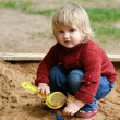 Child plays with sand — Stock Photo