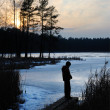 Sunset on the lake in March — Stock Photo