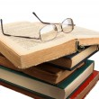 Glasses and open books. - Stock Photo