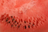 Red background of ripe watermelon. — Stock Photo