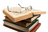 Glasses and open books. — Stock Photo