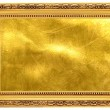 Gold old frame with a gold background - Stock Photo