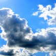 White fluffy clouds in the blue sky — Stock Photo #1011211