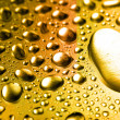 Royalty-Free Stock Photo: Golden close-up water drops background