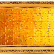 Gold old frames with puzzle — Stock Photo