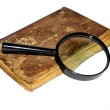 Book and glass loupe — Stock Photo