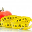 Tomato and measuring tape diet concept — Stock Photo