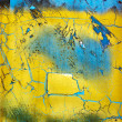 Photo: Weathered blue and yellow surface