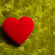 Photo: Heart on green background