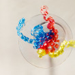 Royalty-Free Stock Photo: Streamers in a glass of martini