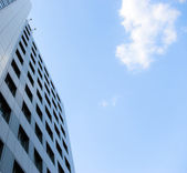 Urban scene - office building and cloud — Stock Photo