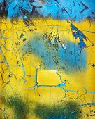 Väderbitna blå och gul yta — Stockfoto