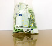 Many currency euro in a package — Stock Photo
