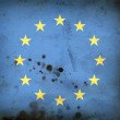 Burned flag of European union - Stock Photo