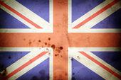 Burned flag of United kingdom — Stock Photo