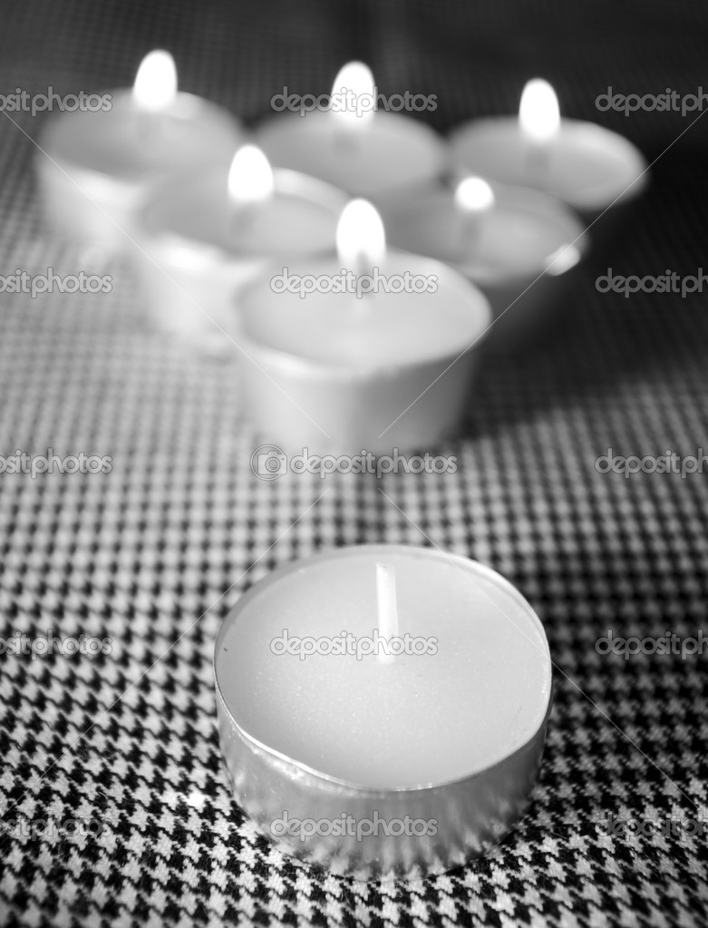 The group candles is built in a triangle and burn all but one — Stock fotografie #1041228