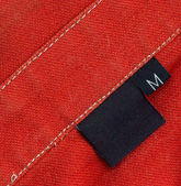 Black tag on a clothes — Stock Photo