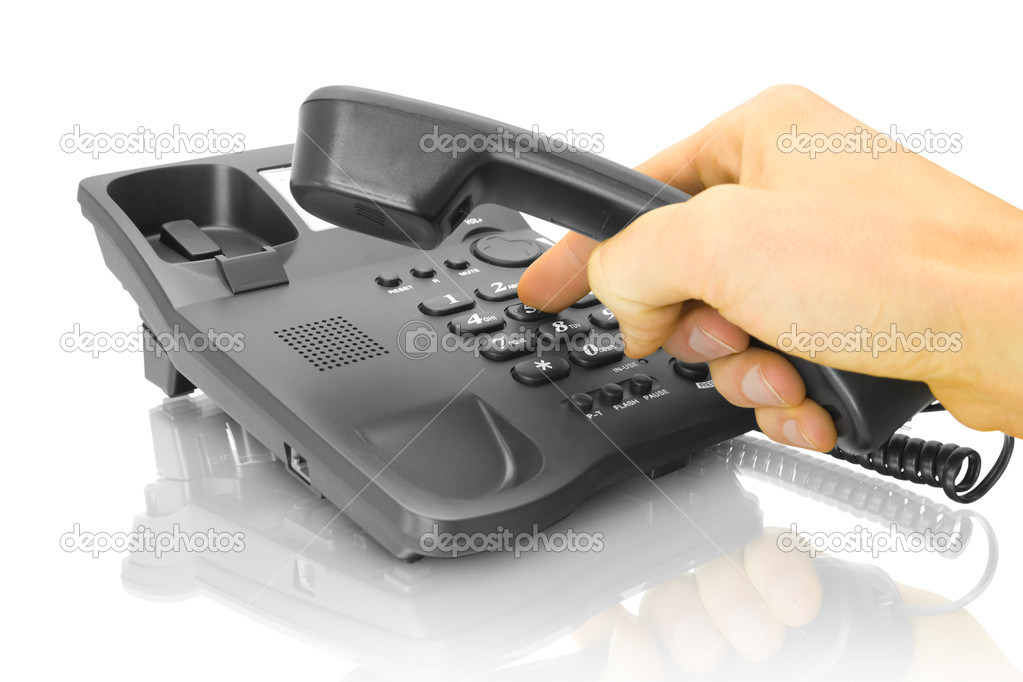 Office black telephone with hand isolated on white — Stock Photo #1005844