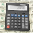 Calculator on money — Stock Photo