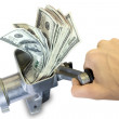 Hand and grinder with dollars — Stock Photo