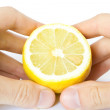 Royalty-Free Stock Photo: Lemon in hands