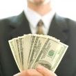 Money in hand of businessman — Stock Photo