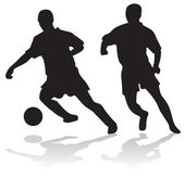 Silhouettes of soccer players — Stock Photo